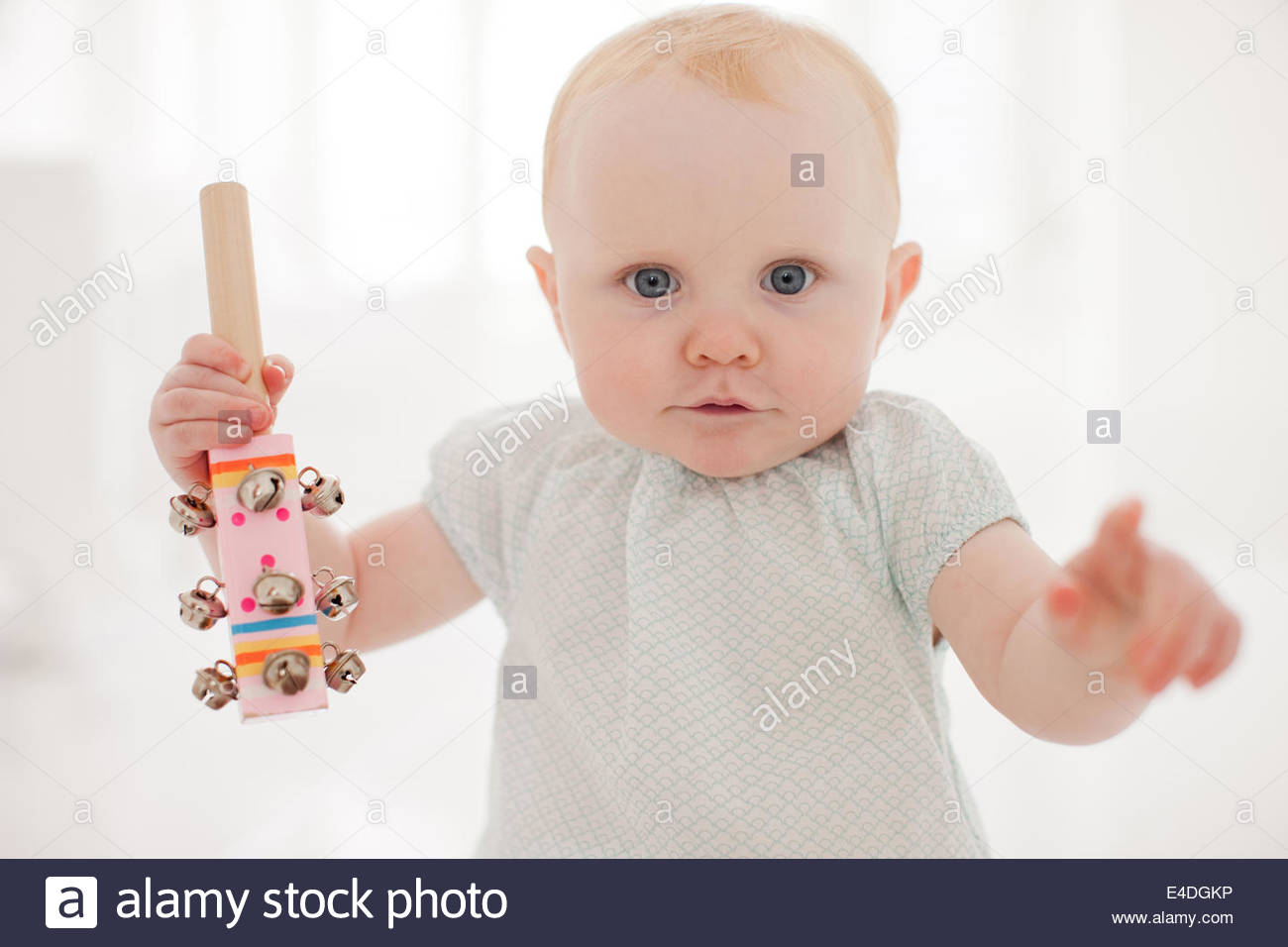 Baby sitting on floor - Stock Image