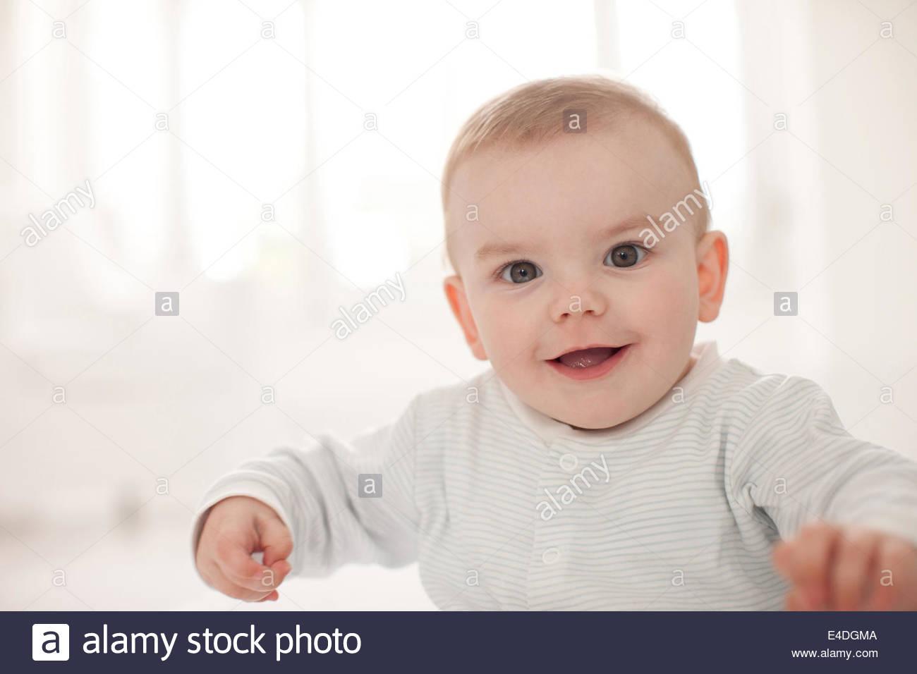 Closeup of smiling baby - Stock Image