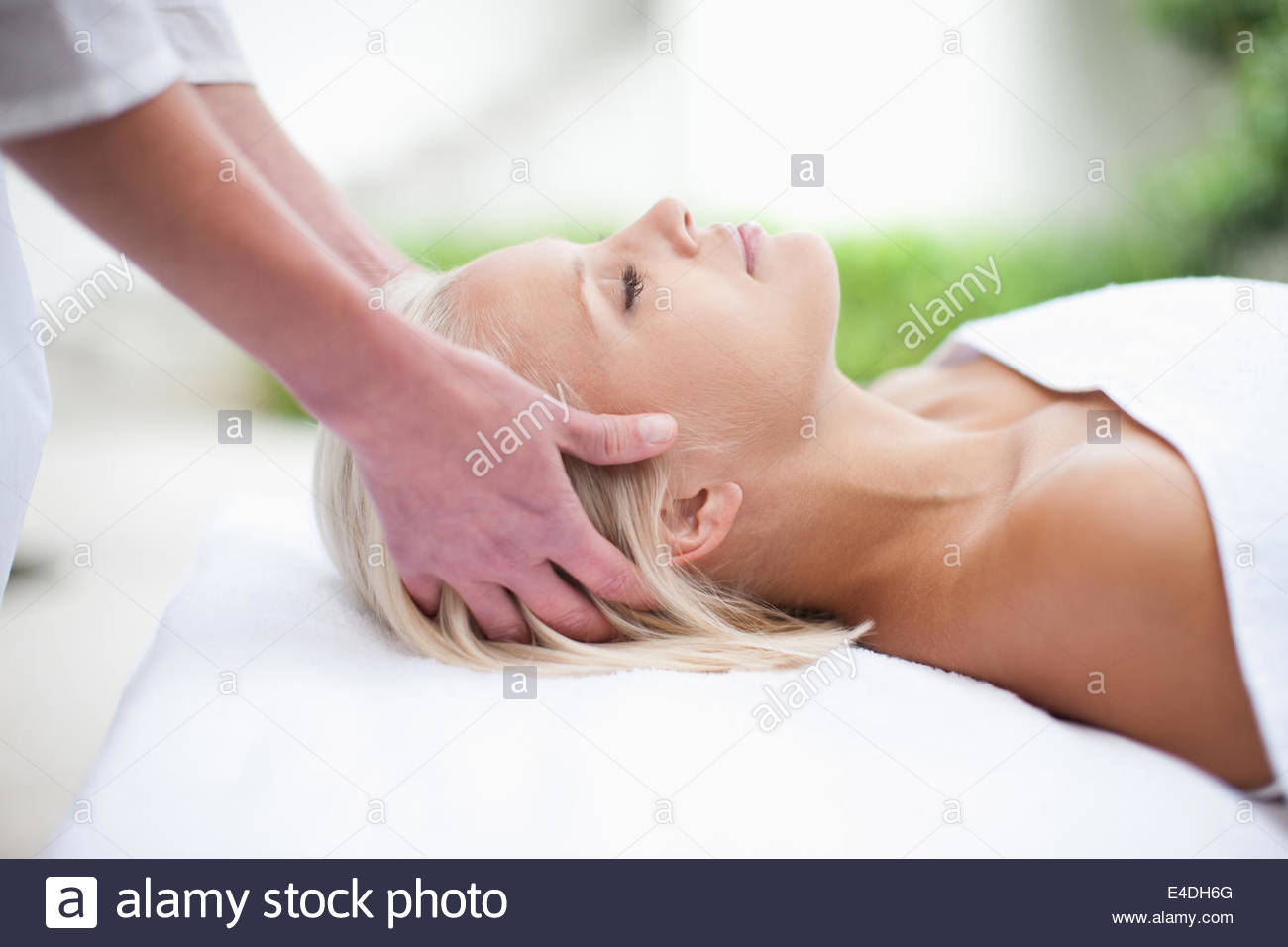Woman receiving massage - Stock Image
