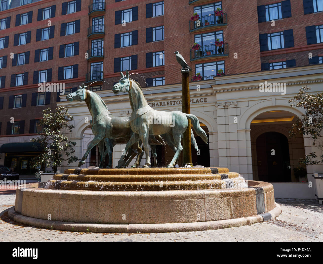 bronze sculpture of four horses in front of charleston place stock photo  71606034