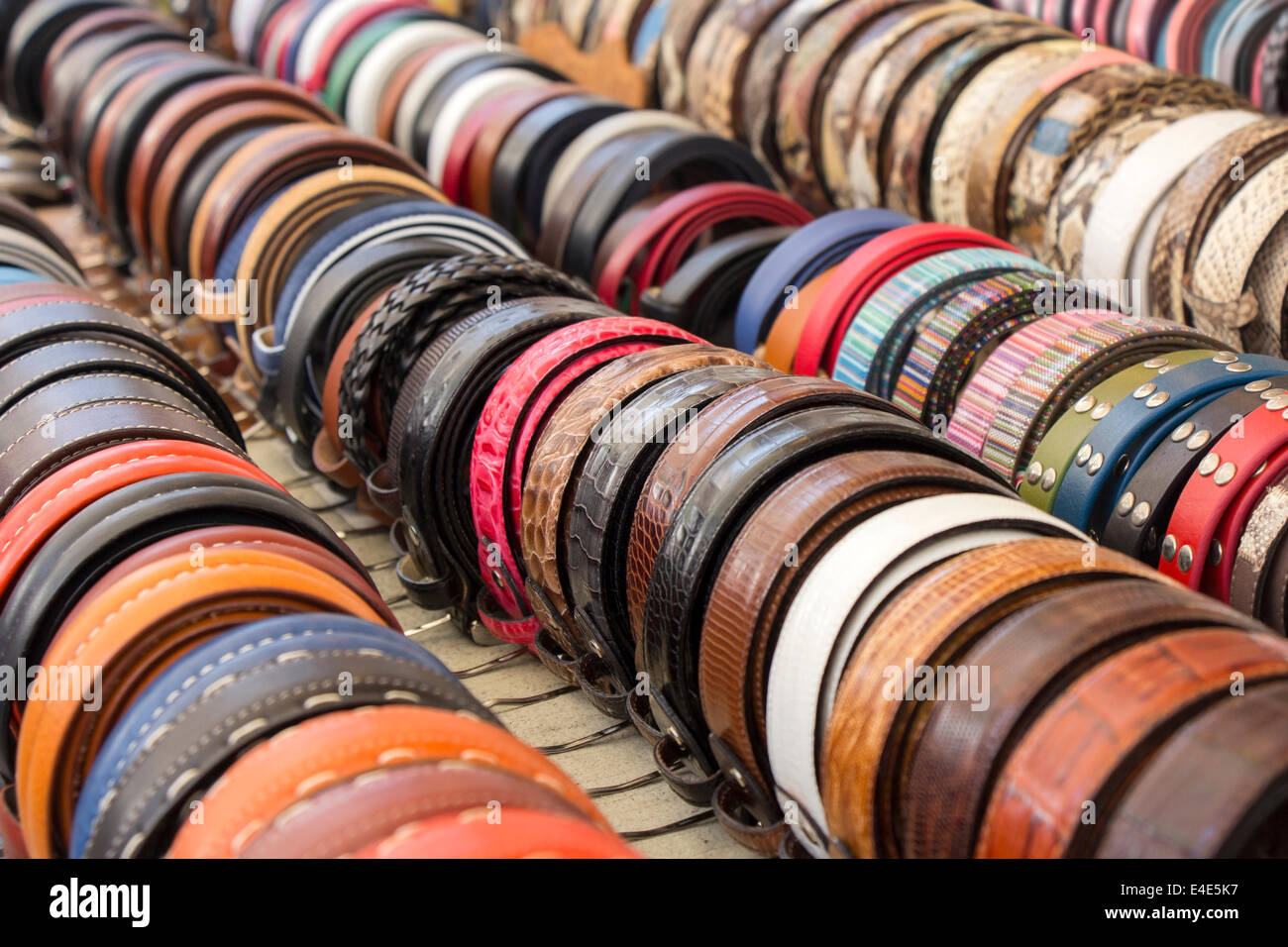 Set of different and colorful leather belts as a background - Stock Image