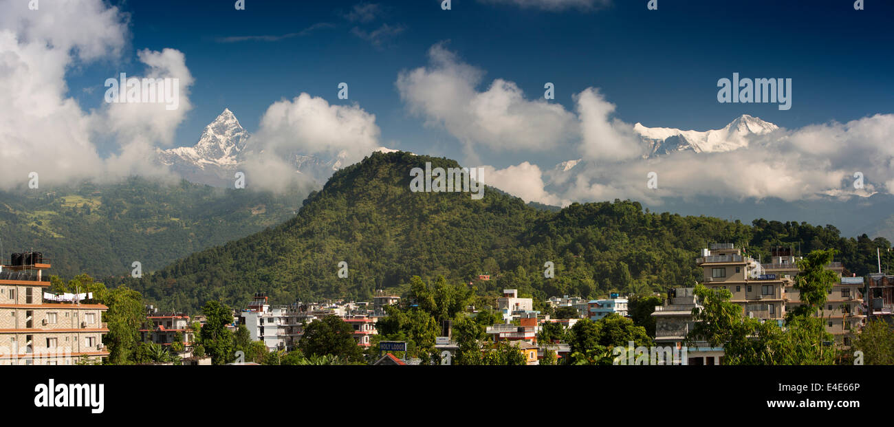 Nepal, Pokhara, Machhapuchchhre and Annapurna Mountain Range above the town panoramic - Stock Image