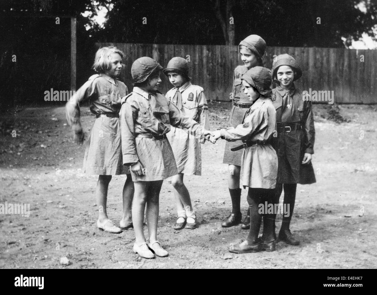 Welcoming a new recruit Brownie Girl Guides 1936  Guiding guide group 1930s uk - Stock Image
