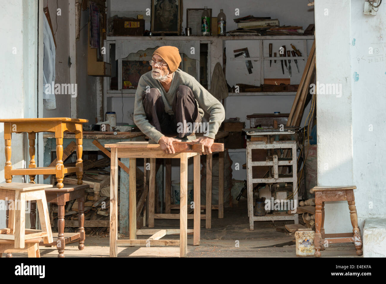 UDAIPUR, INDIA - JANUARY 2014: A carpenter working on furniture in Udaiper 3rd of January 2014. - Stock Image