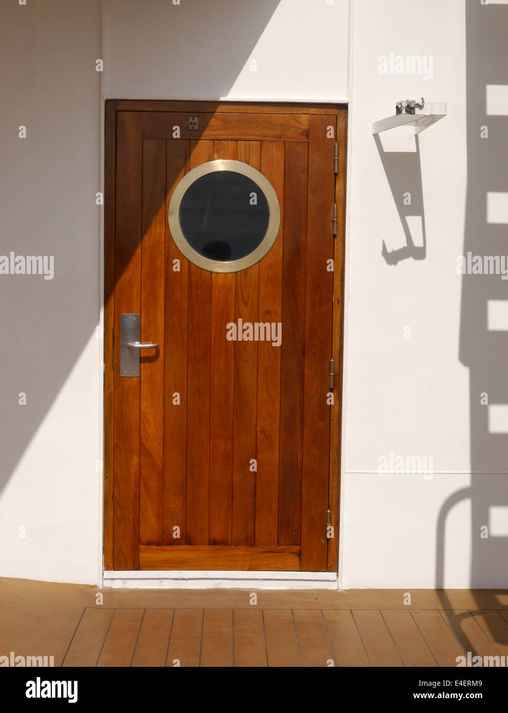 A varnished door with a porthole on the deck of a cruise ship & A varnished door with a porthole on the deck of a cruise ship Stock ...