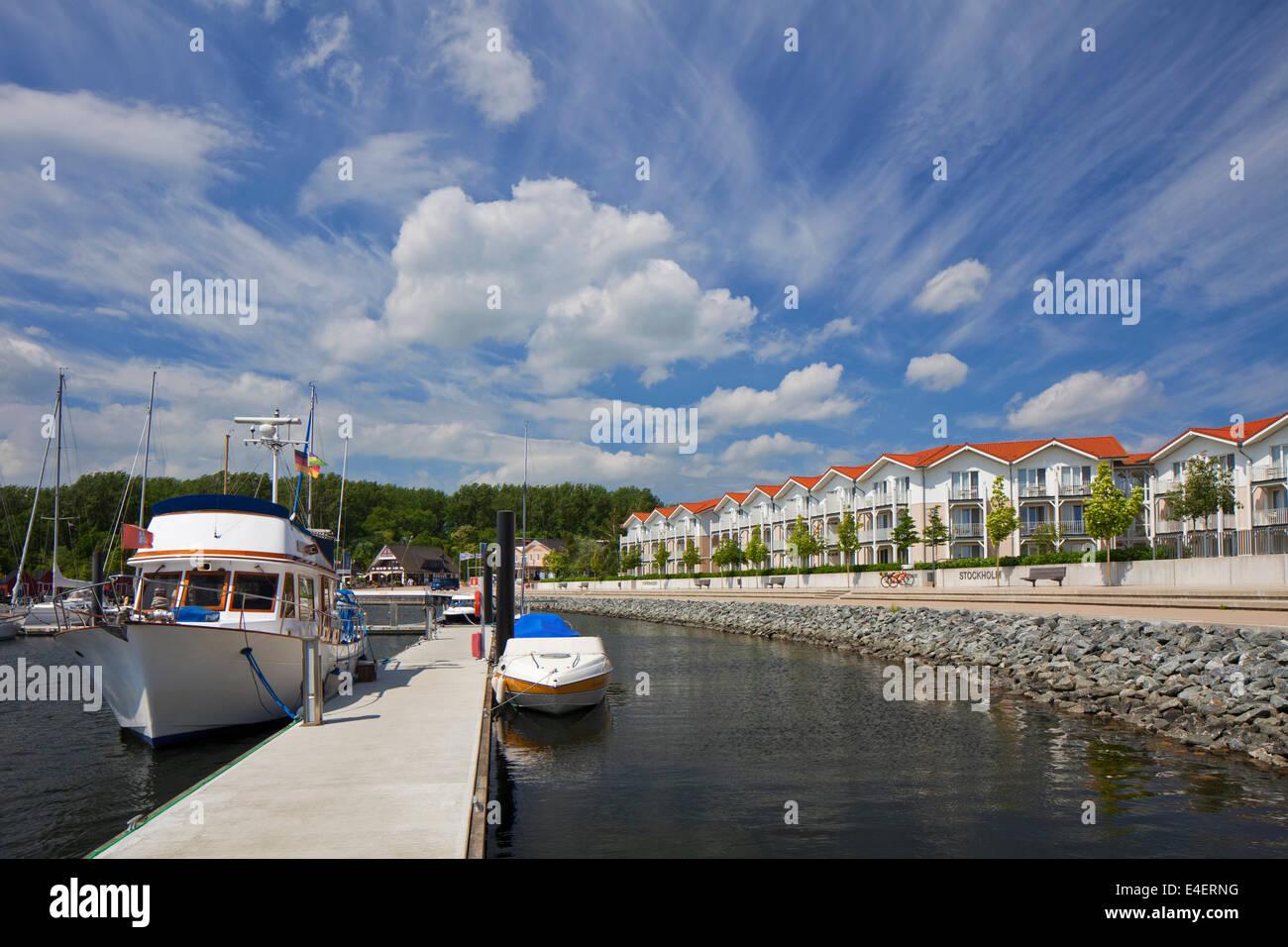 Pleasure boats docked in marina of the holiday resort Weisse Wiek / Weiße Wiek at Boltenhagen, Mecklenburg - Stock Image