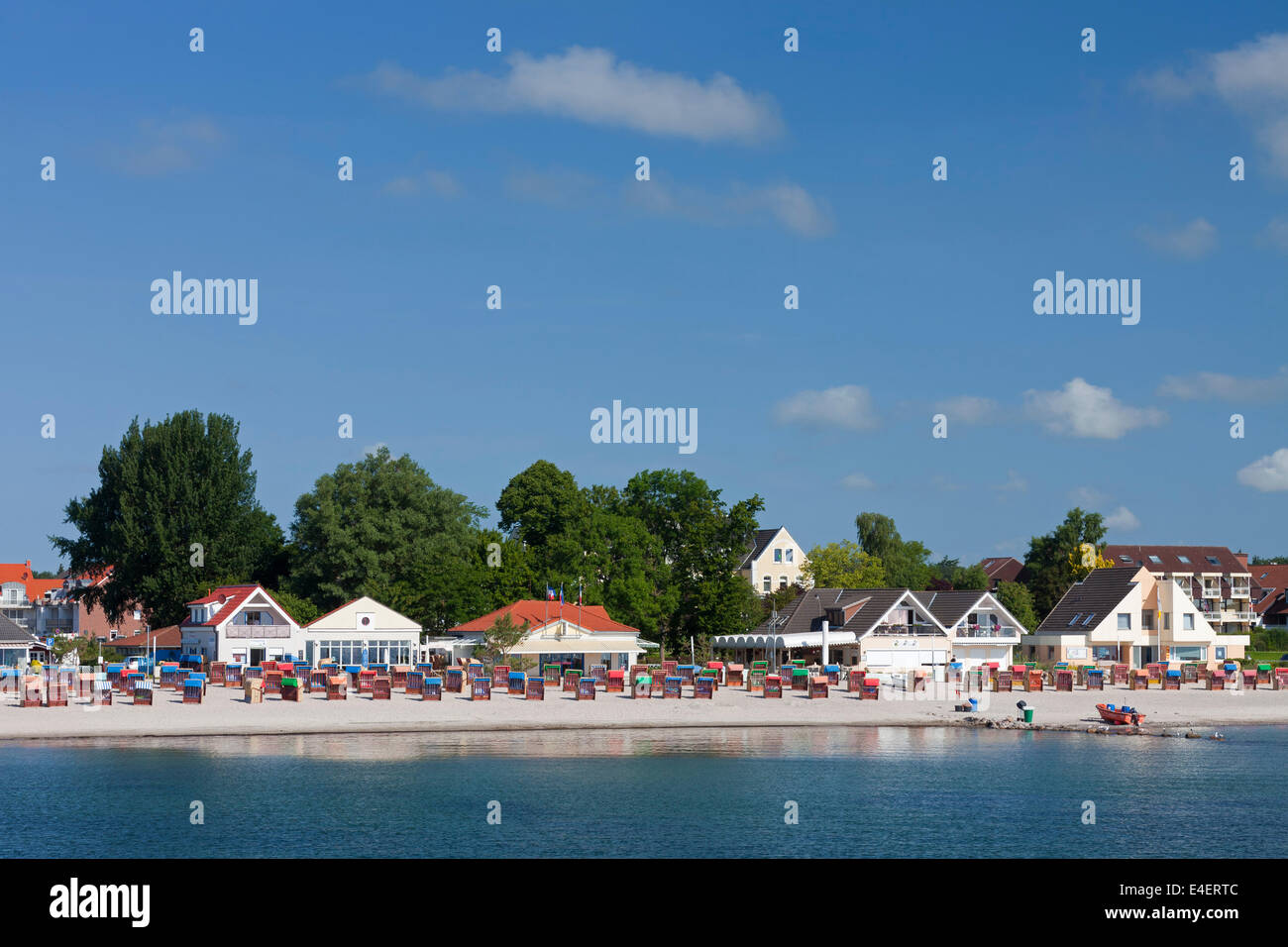 Roofed wicker beach chairs at Kellenhusen, seaside resort along the Baltic Sea , Schleswig-Holstein, Germany - Stock Image