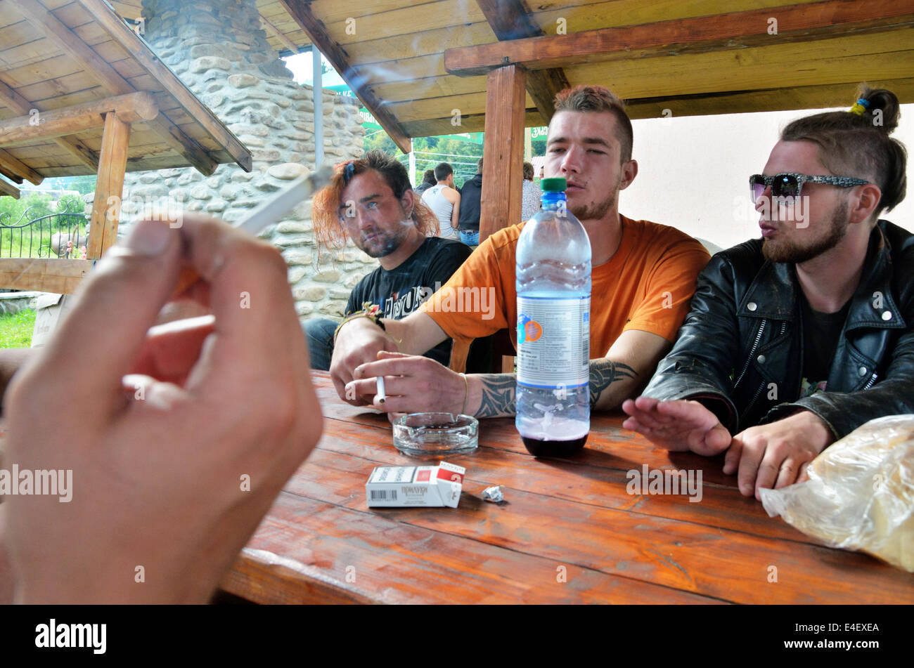 Carpathian Mountains, Ukraine. 8th July, 2014. Group of punks resting in the caff on the Shypit Festival / Festival - Stock Image