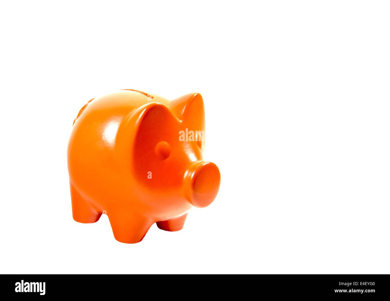 Orange piggybank isolated over white - Stock Image