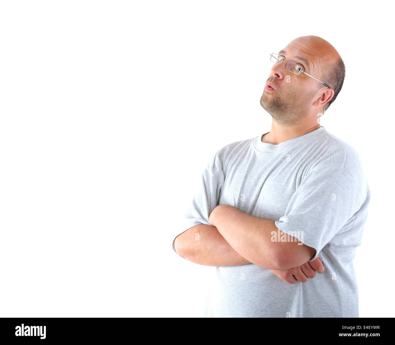 Man looking skeptical into the camera - Stock Image