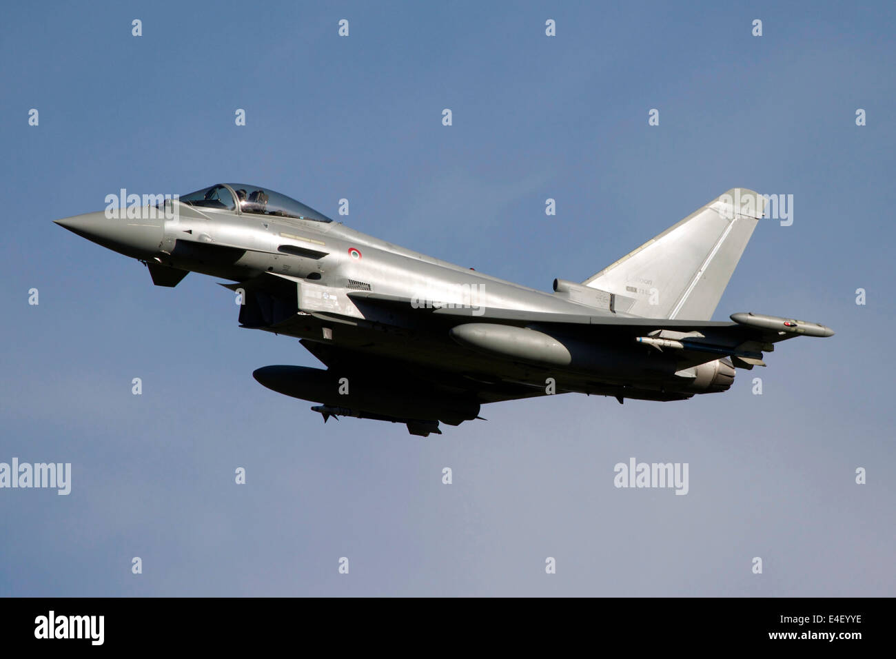 A Eurofighter Typhoon 2000 multirole fighter aircraft of the Italian Air Force in flight over Italy. - Stock Image