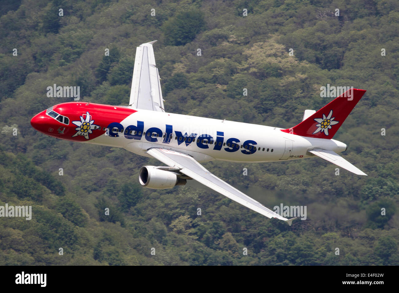 An Airbus A320 of Edelweiss Air in flight over Locarno, Switzerland. - Stock Image