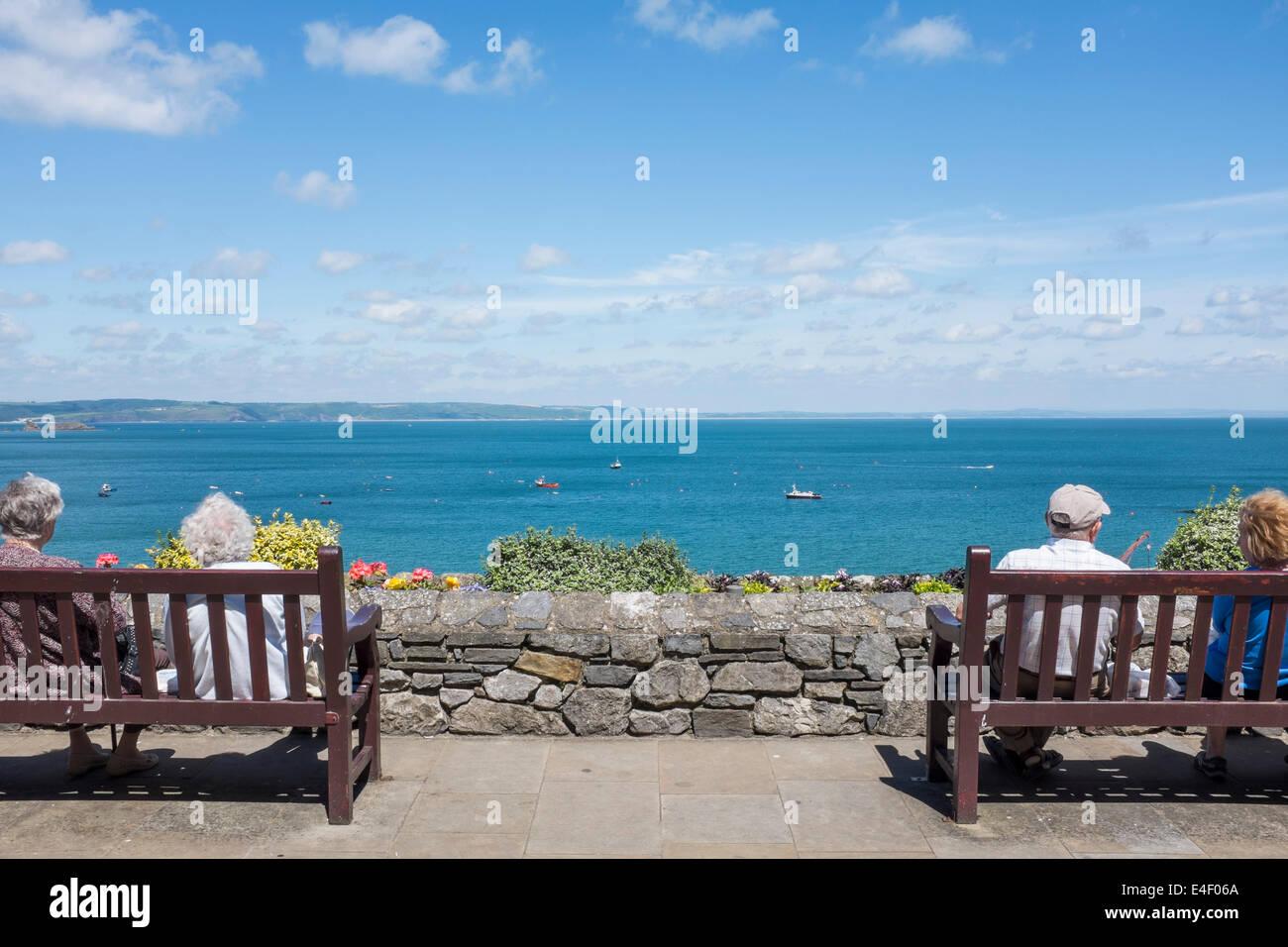 Old people enjoying retirement in Tenby - Stock Image