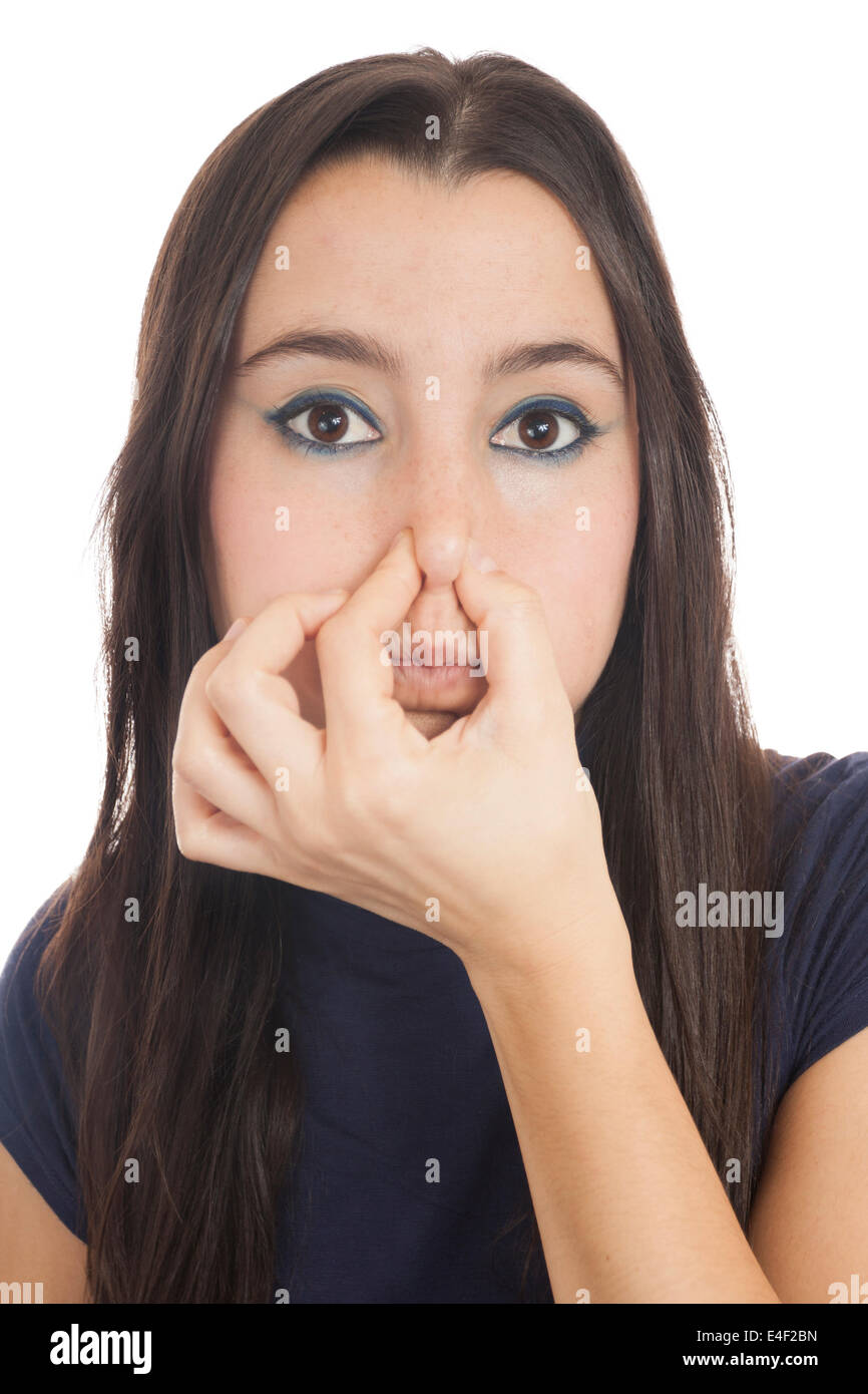 Close-up of a woman holding her nose isolated on white Background - Stock Image