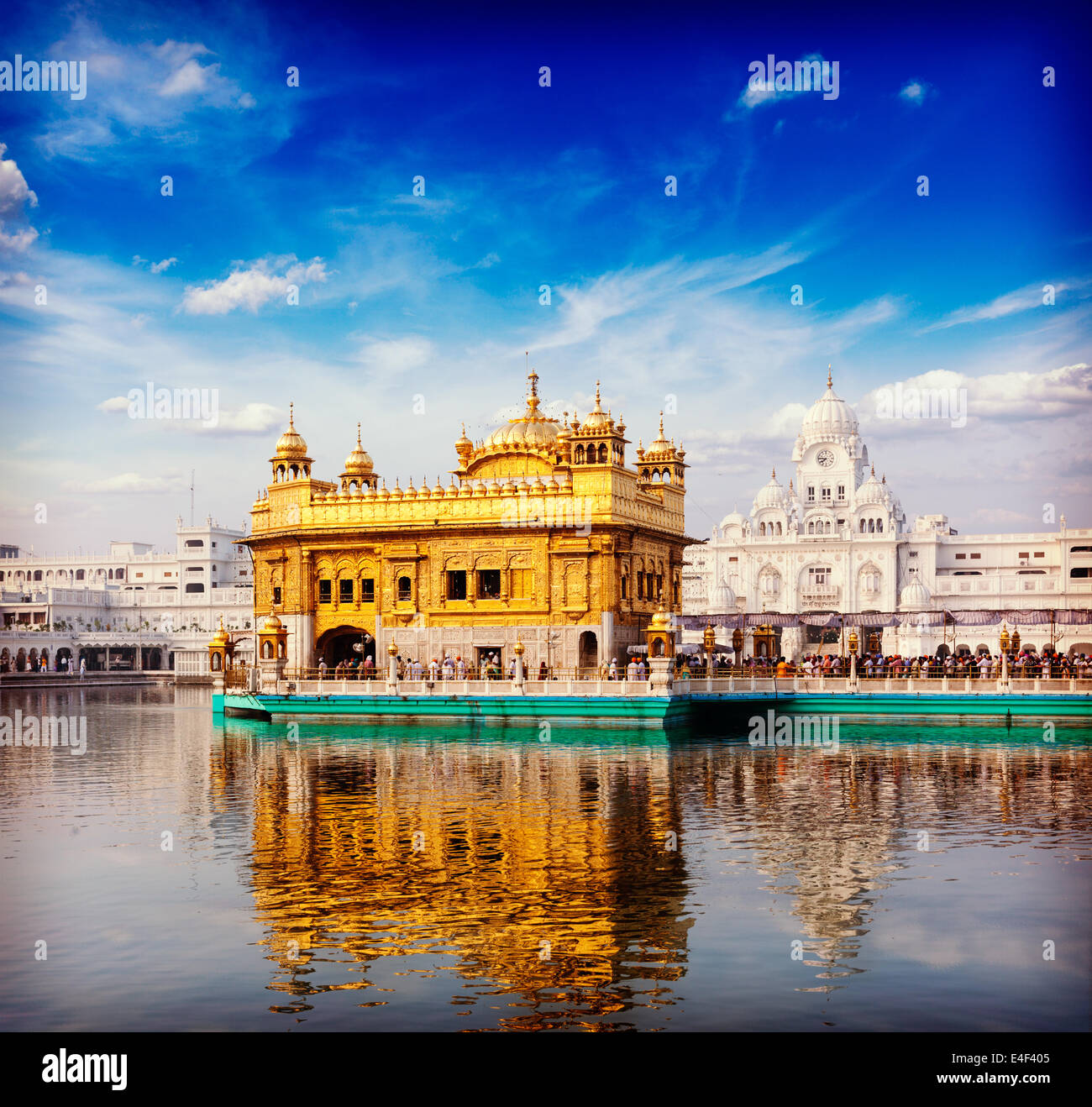 Vintage retro hipster style travel image of famous India attraction Sikh gurdwara Golden Temple (Harmandir Sahib). - Stock Image