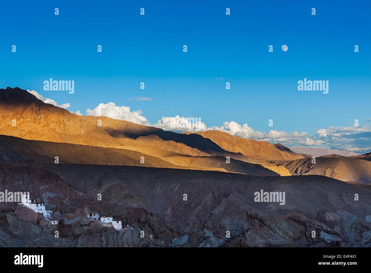 Basgo Gompa (Tibetan Buddhist monastery) and Himalayan landscape on sunset and moonrise. Ladakh, India - Stock Image