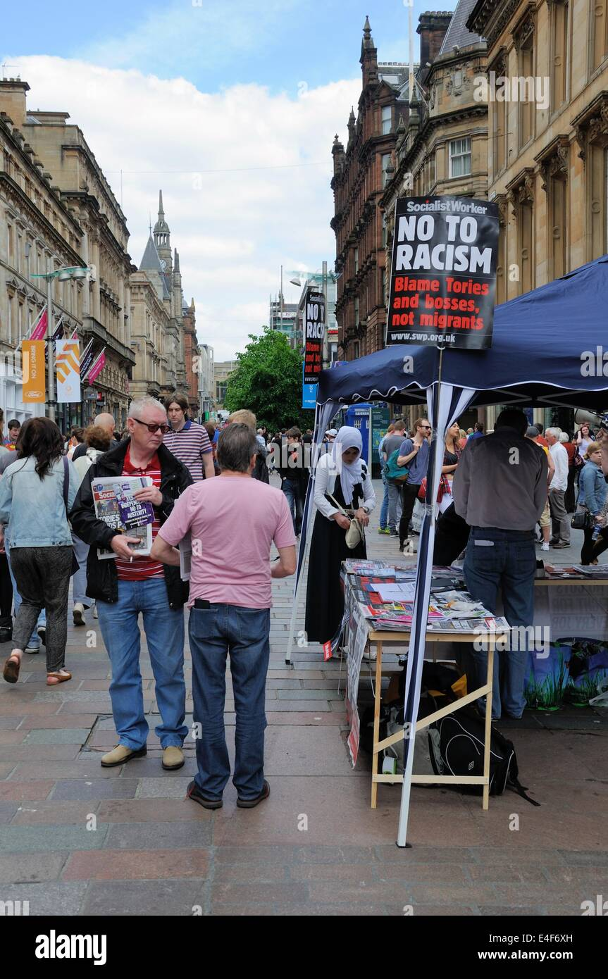 Temporary stand giving out information leaflets on racism in Glasgow, Scotland. - Stock Image