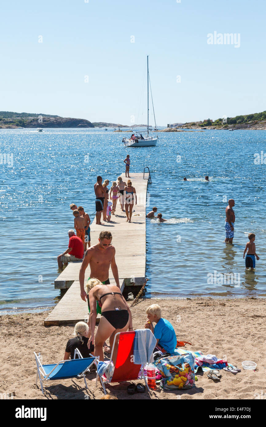 People on the beach on a sunny summer day - Stock Image
