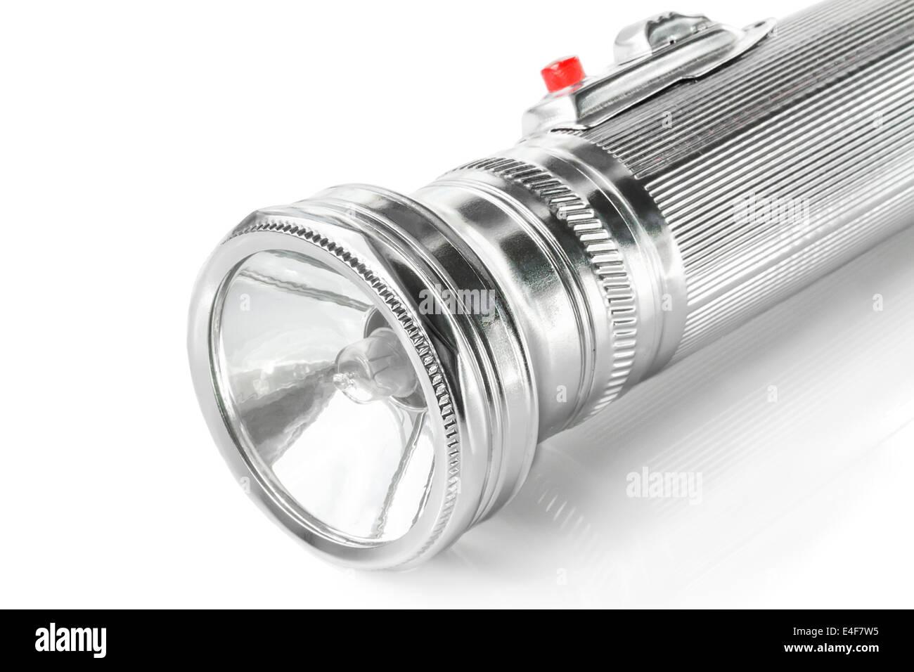 Old metal pocket flashlight isolated on white background - Stock Image
