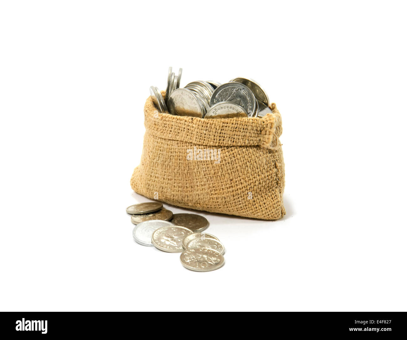 Bag of coins isolated on a white background Stock Photo