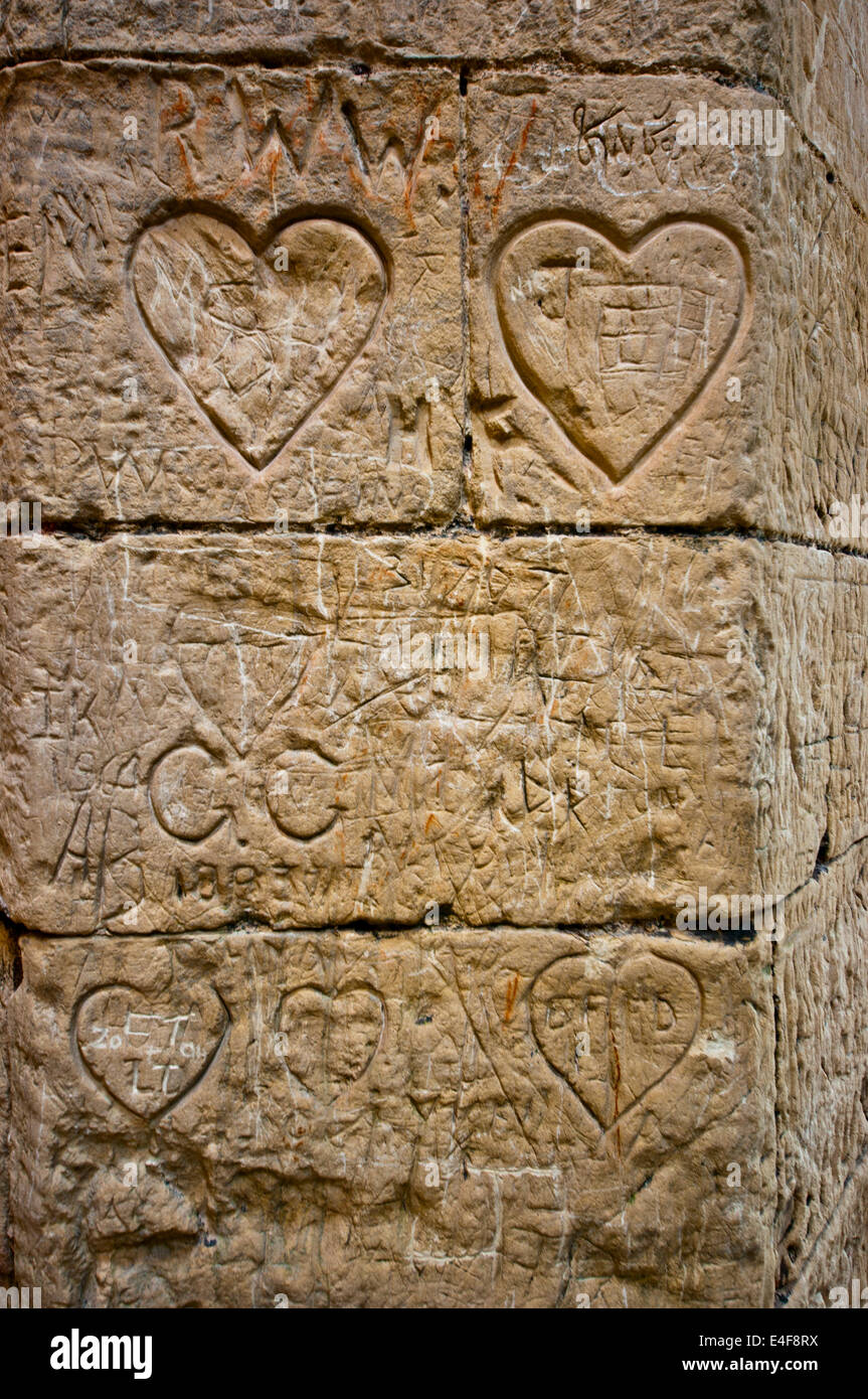 Love hearts carved into medieval wall - Stock Image