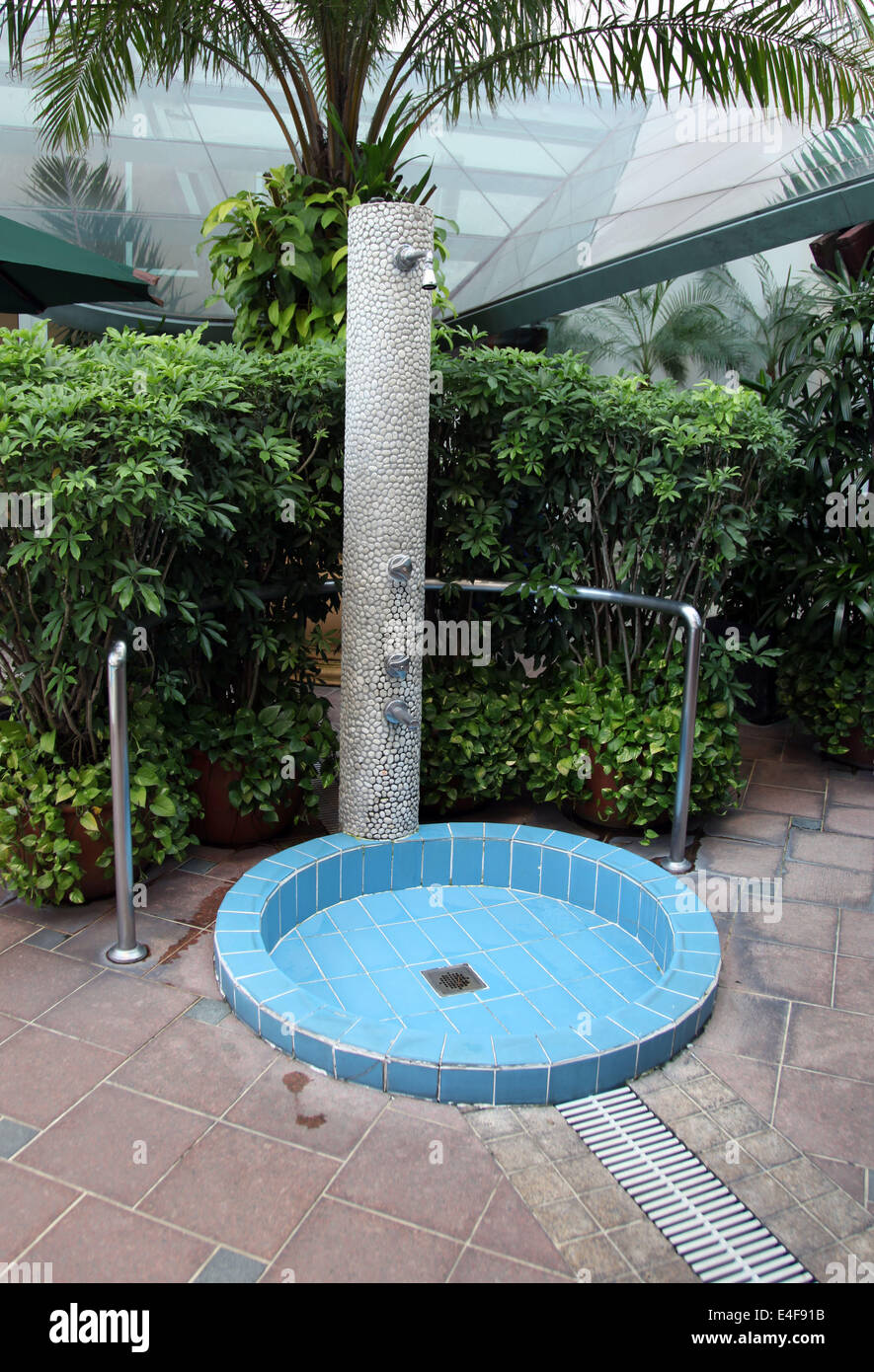 It\'s a photo of an outdoor shower in a resort hotel near a swimming ...