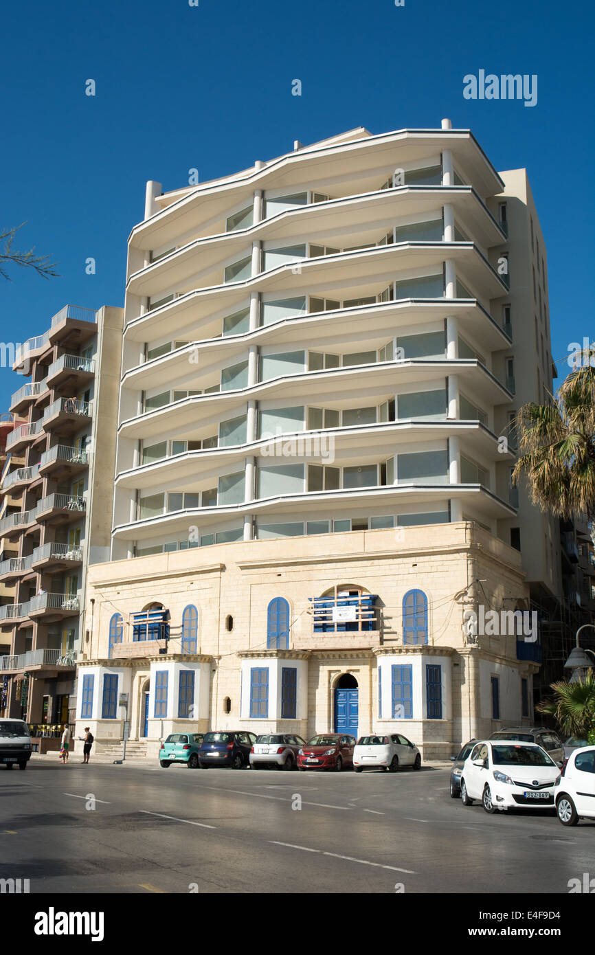 A nearly complete conversion of a Maltese villa to an apartment block. The facade of the original building has been - Stock Image