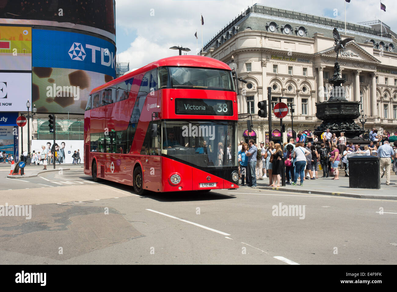 A recently delivered New Routemaster (New bus for London) on route 38 passes Eros in Piccadilly Circus, London - Stock Image