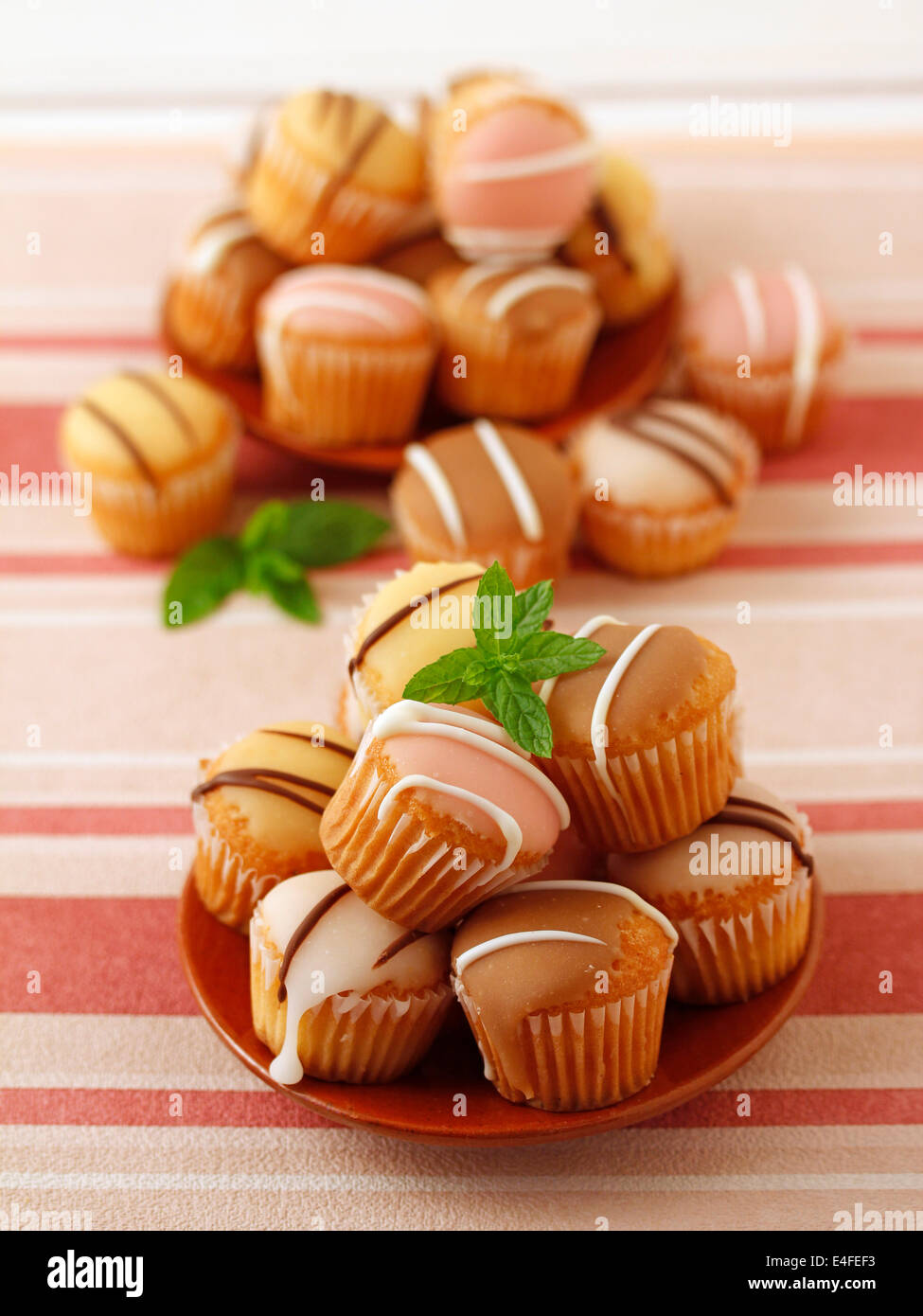 Flavoured minicupcakes. Recipe available. - Stock Image