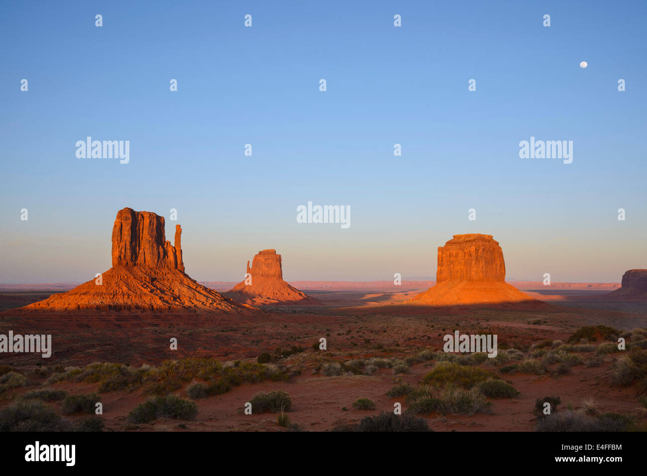 East and West Mitterns and Merrick Butte at sunset, Monument Valley, Arizona, USA - Stock Image