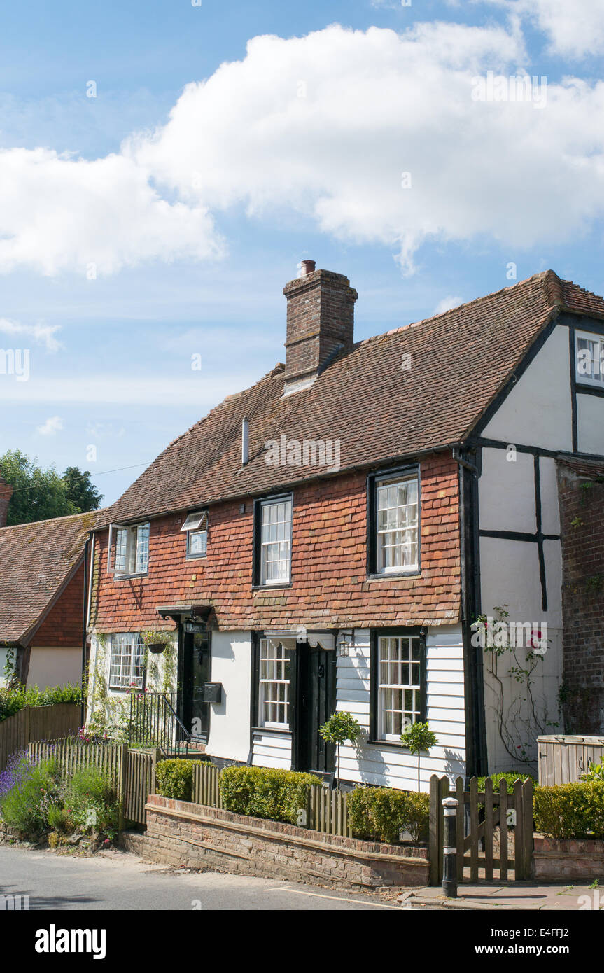 Traditional half timbered cottages with tile hanging on the front elevation Burwash, East Sussex, England UK - Stock Image
