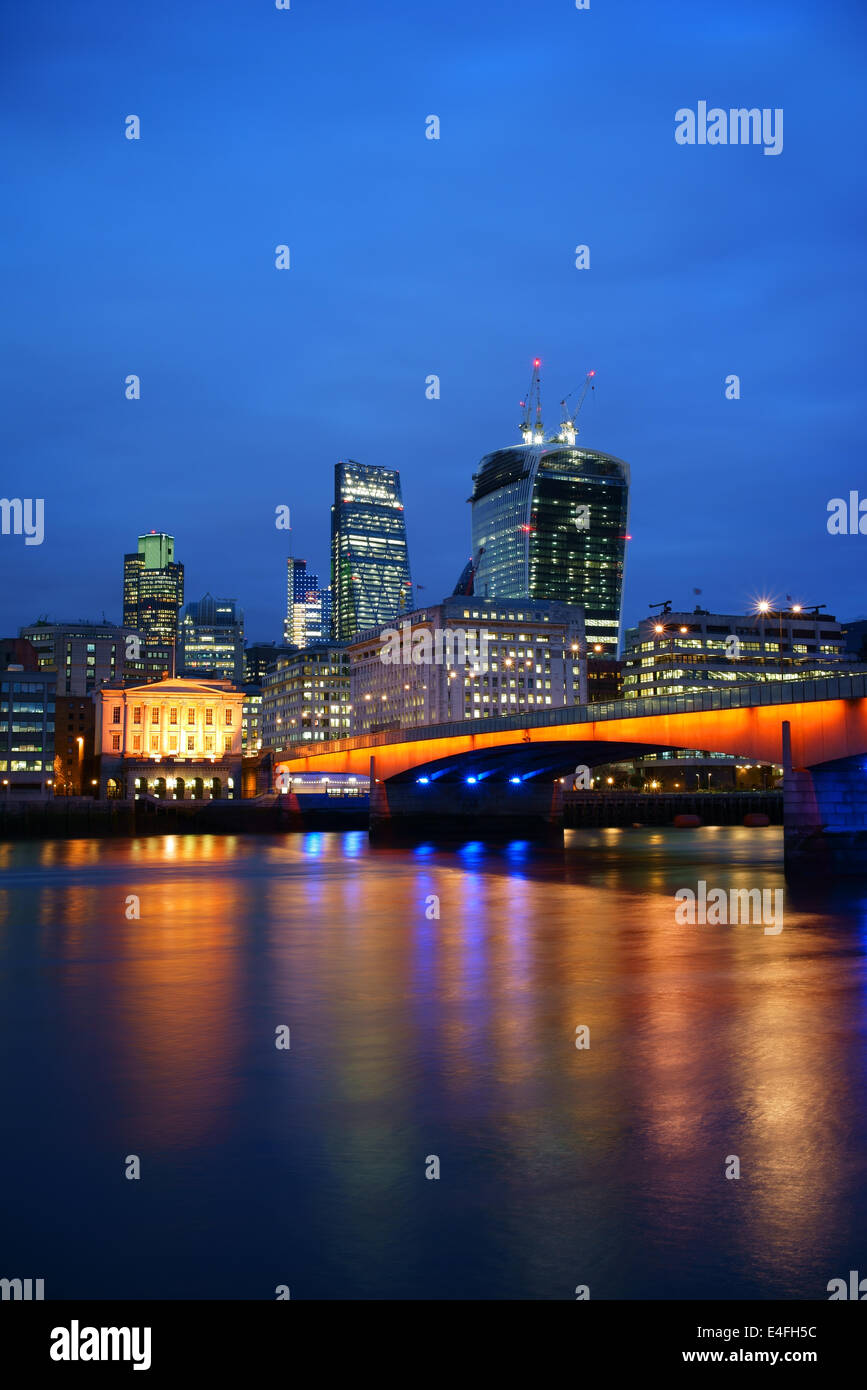 UK,London,London Bridge,River Thames & City of London Skyline at dusk - Stock Image