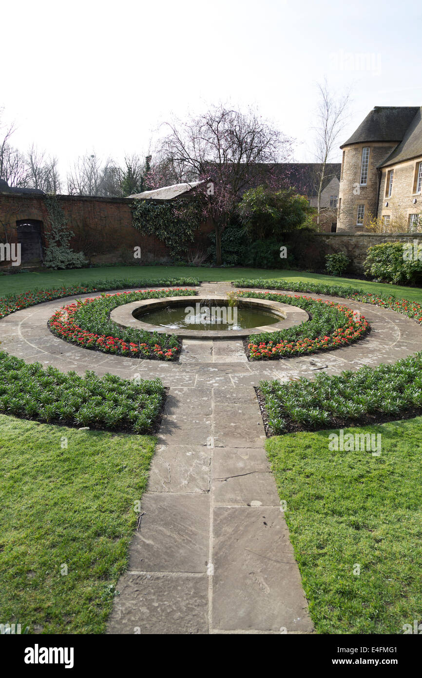 UK, Oxford, formal walled English garden with pond, in the grounds of Christ Church College. - Stock Image