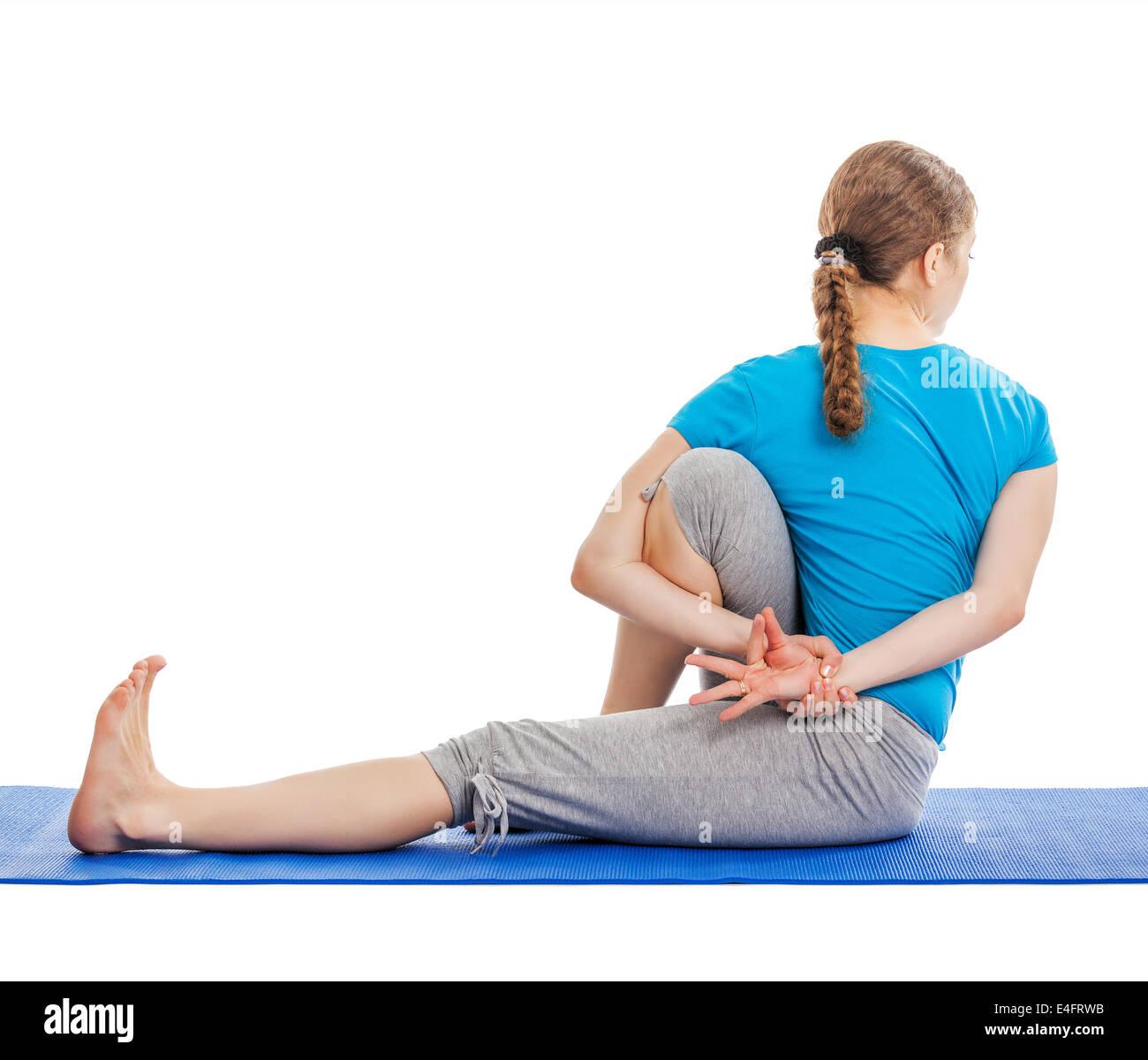Yoga - young beautiful slender woman yoga instructor doing Forward Bends Sage Twist C pose (Marichyasana C) asana - Stock Image