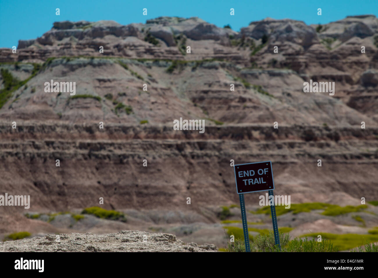 End of trail sign and badlands - Stock Image