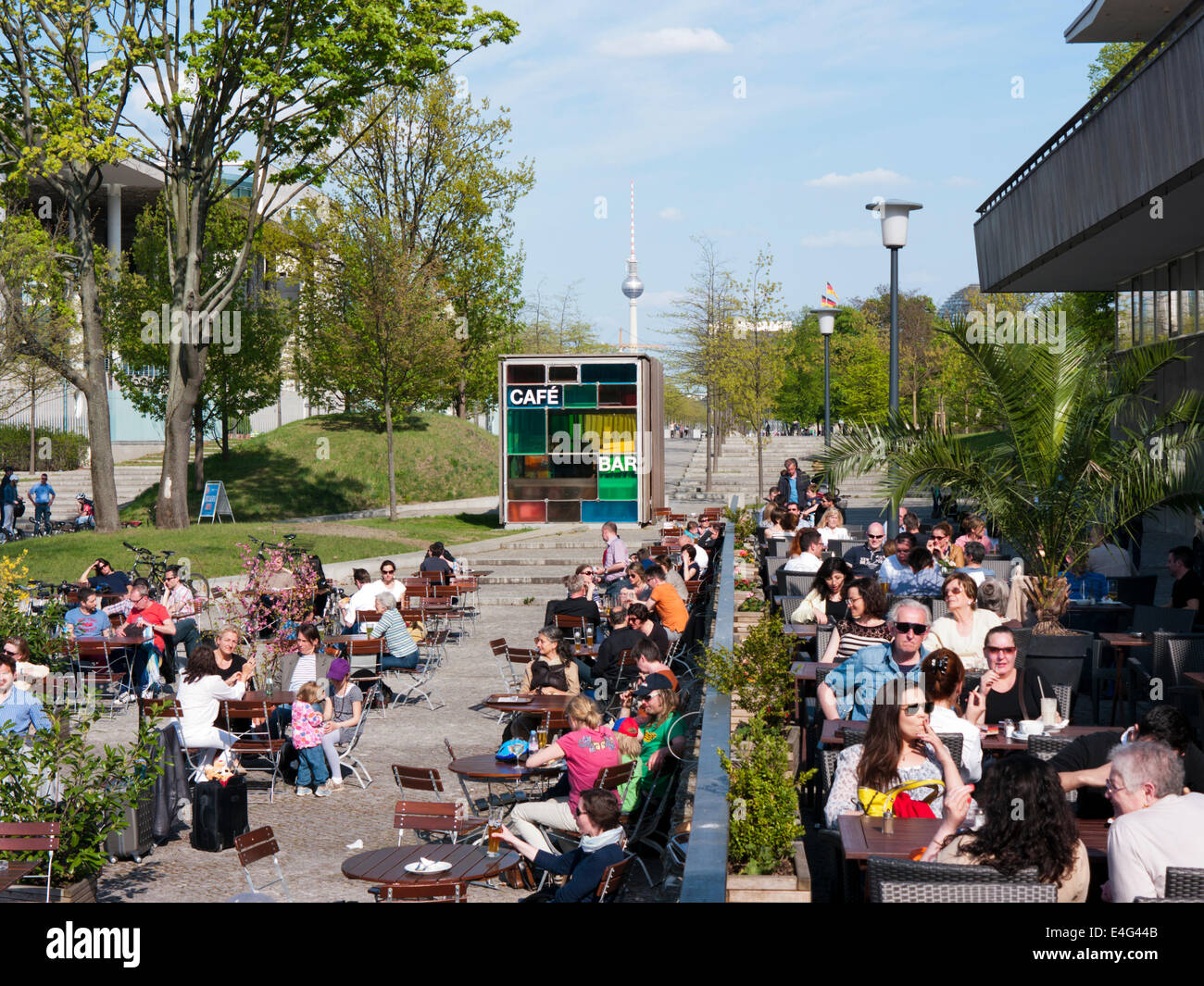 A cafe bar restaurant outside The House of Worlds Cultures in Berlin Germany - Stock Image