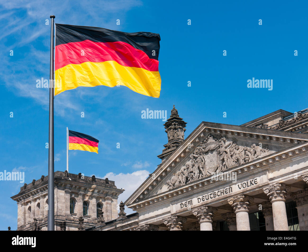 The German flag flying outside the Reichstag building in Berlin Germany - Stock Image