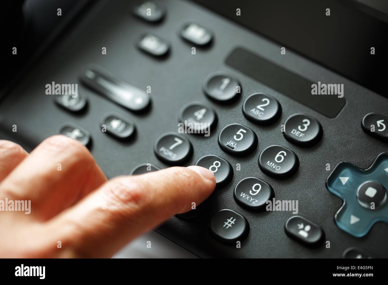 Dialing telephone keypad - Stock Image