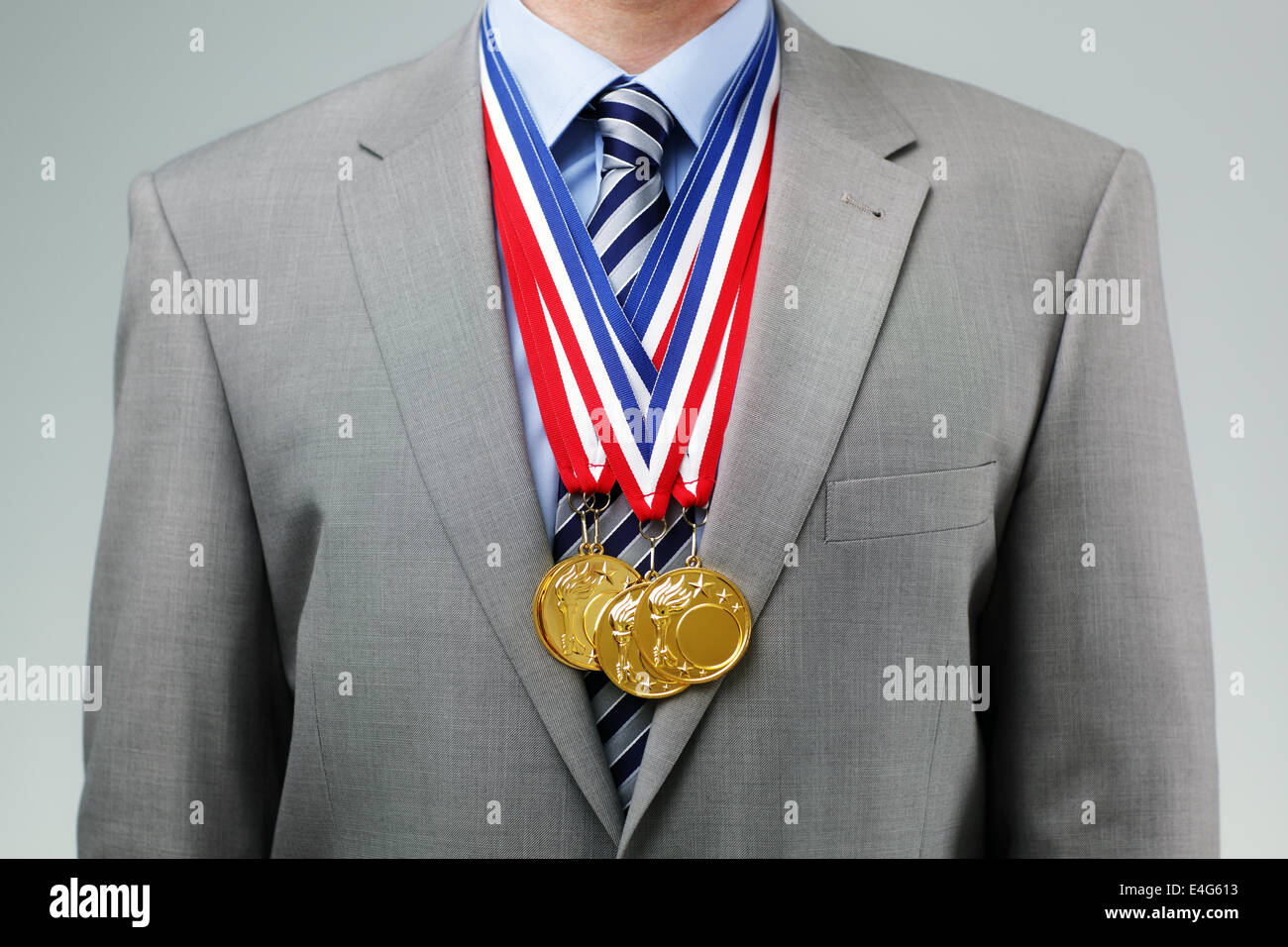 Successful businessman with gold medals - Stock Image