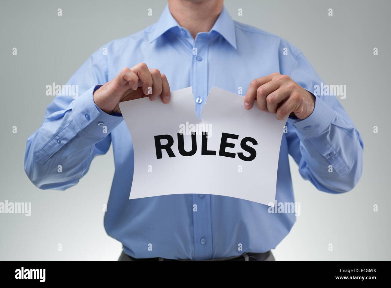 Tearing up the rules - Stock Image