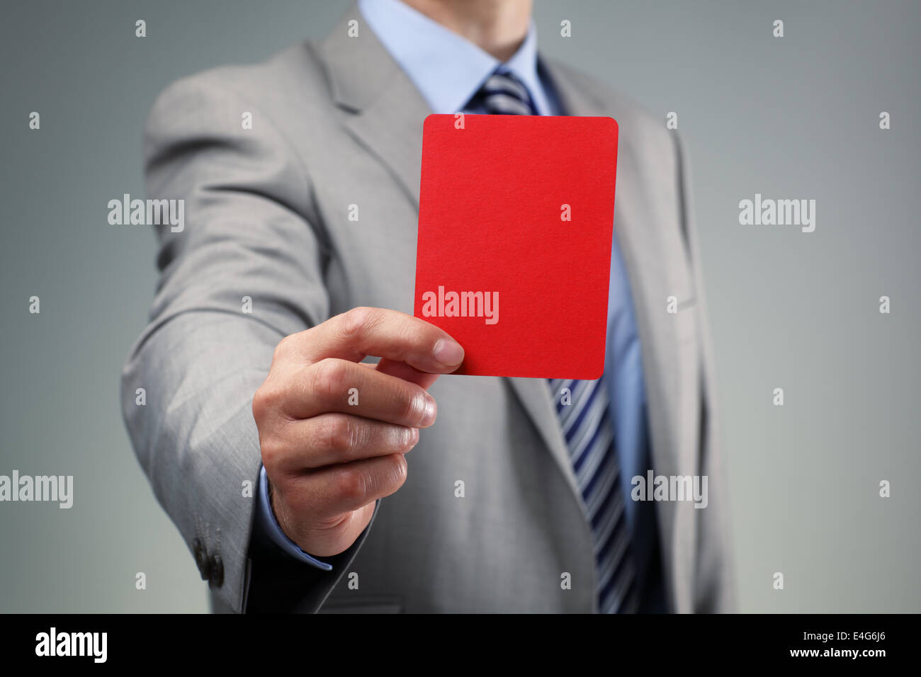 Businessman showing the red card - Stock Image