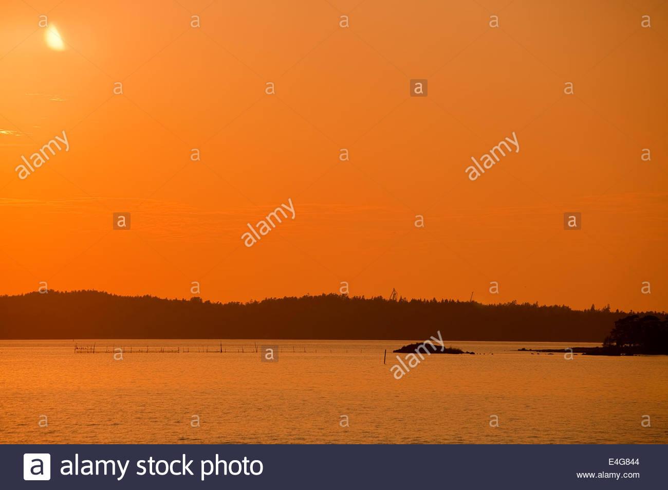 Orange sky in Turku Finland - Stock Image