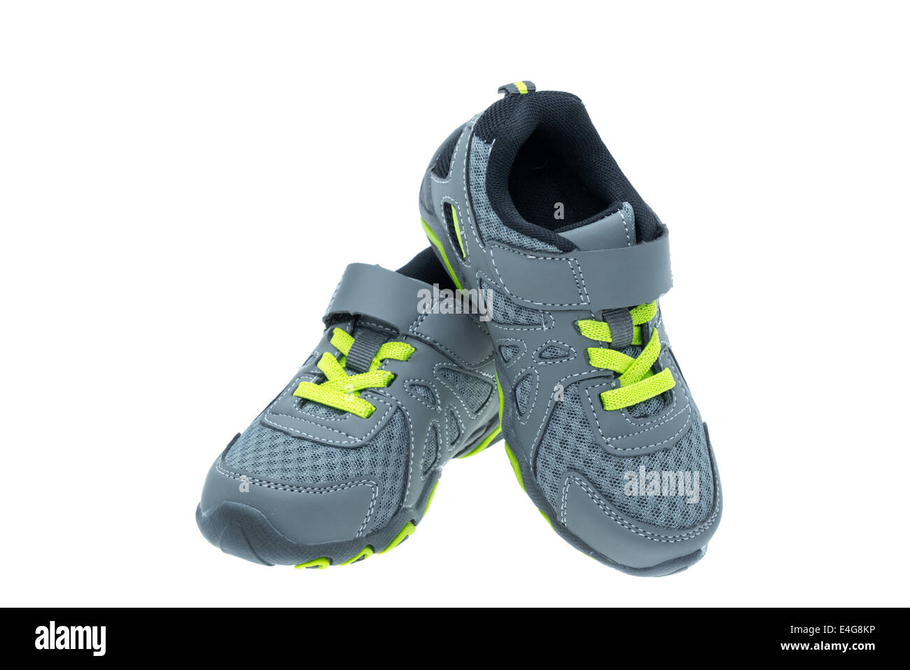 Child's sports shoes - studio shot with a white background - Stock Image