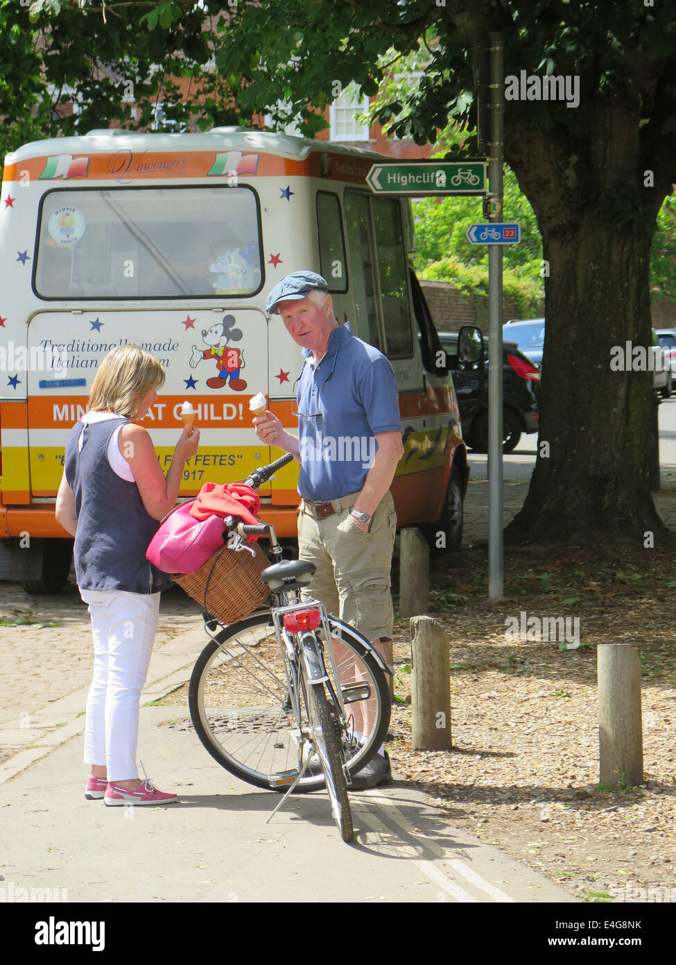 Tourists eating ice cream in Winchester Hampshire England UK - Stock Image