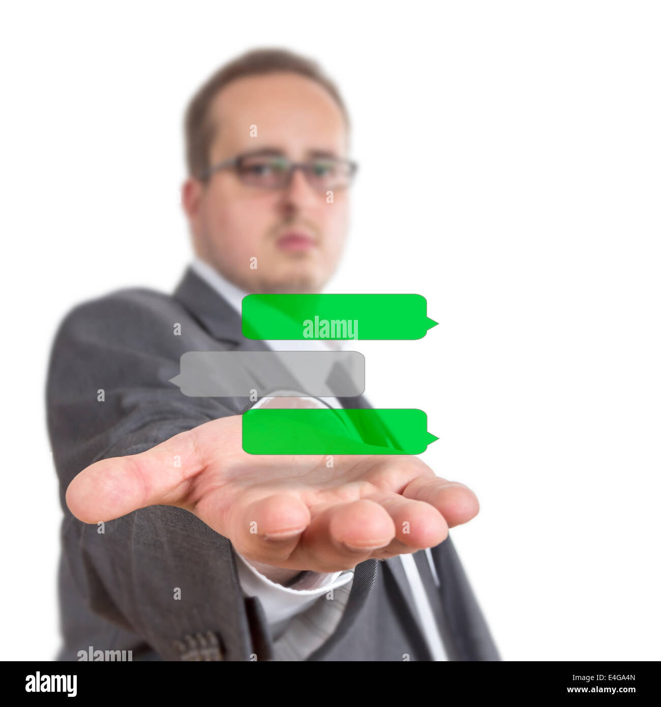Business man reaches out his arm with text message chat history symbols floating over his hand. Isolated on White - Stock Image