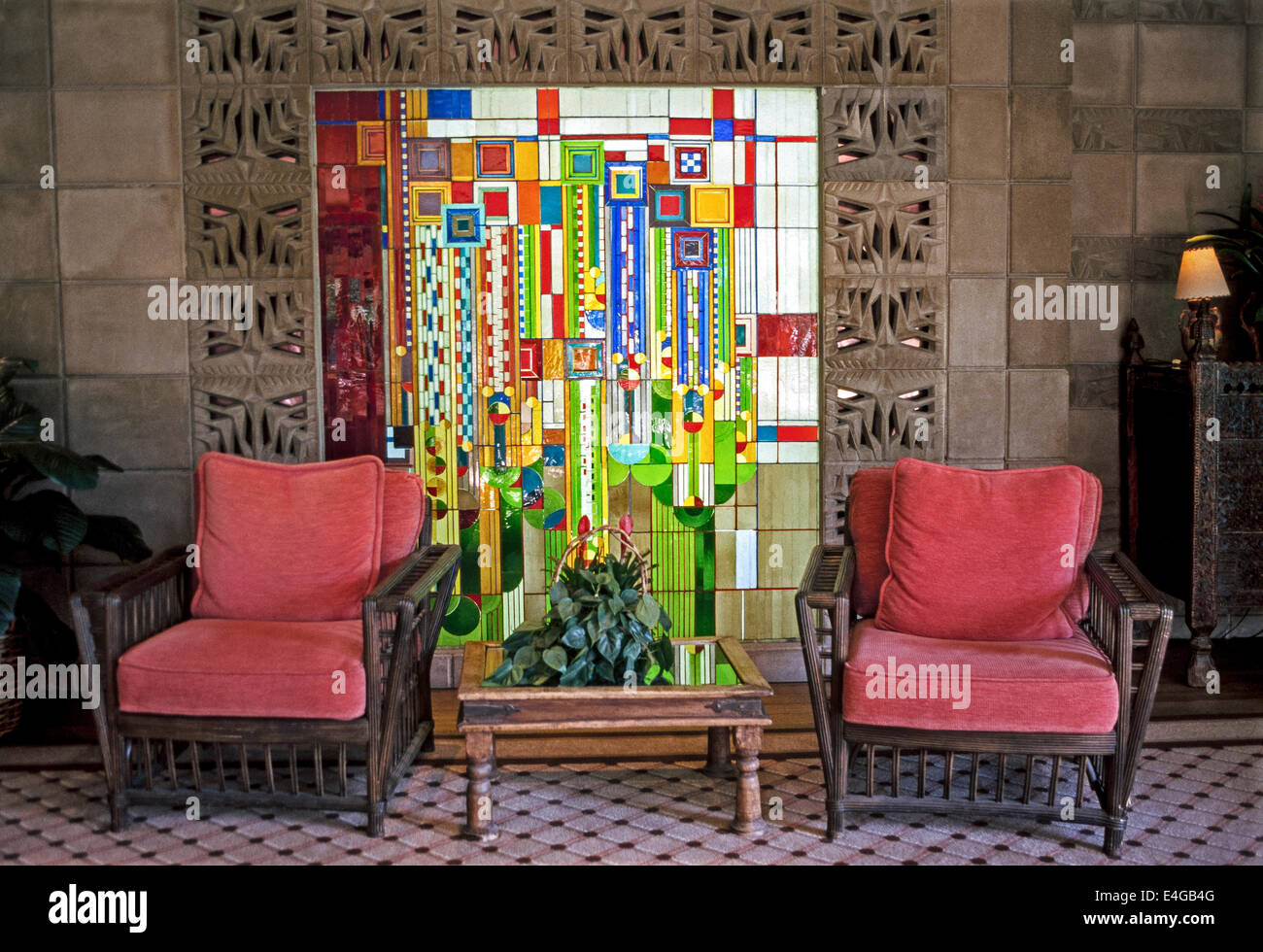 This colorful 1970s stained-glass window by architect Frank Lloyd Wright greets guests at the Arizona Biltmore Hotel - Stock Image