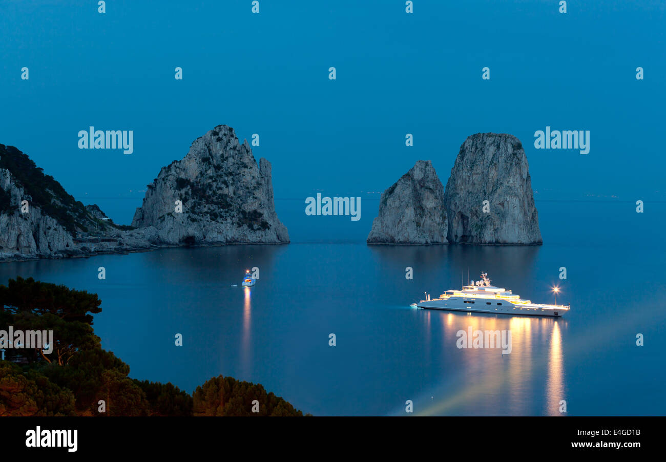 Faraglioni by night, famous giant rocks, Capri island in Italy - Stock Image