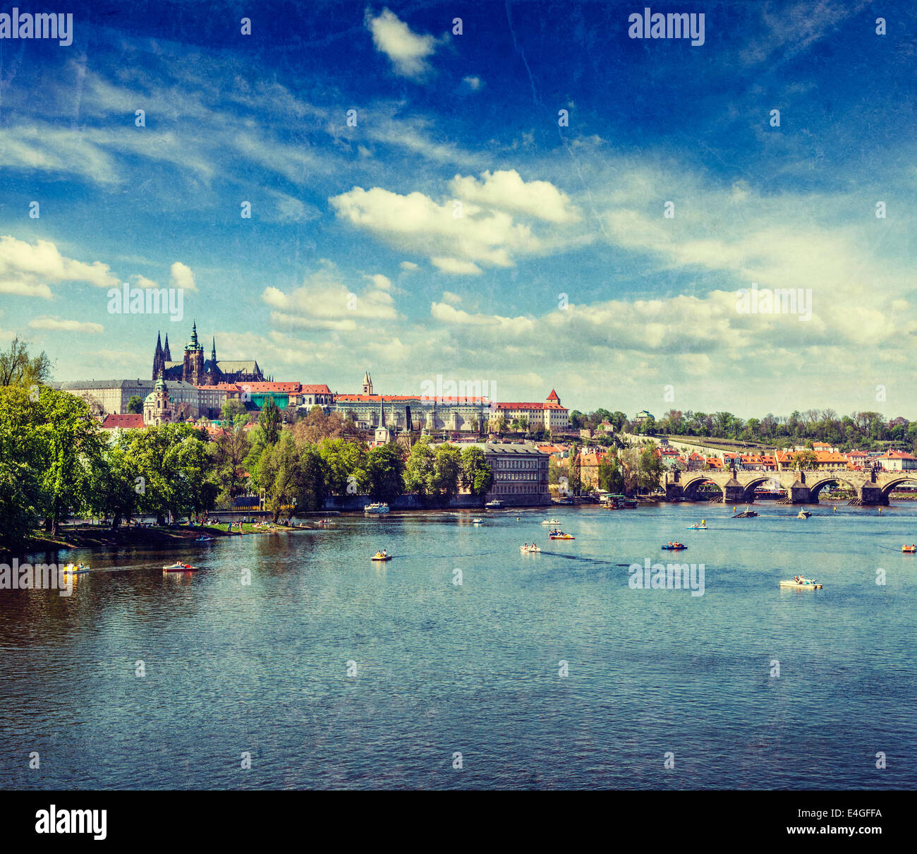 Vintage retro hipster style travel image of  Vltava river and Gradchany (Prague Castle) and St. Vitus Cathedral - Stock Image