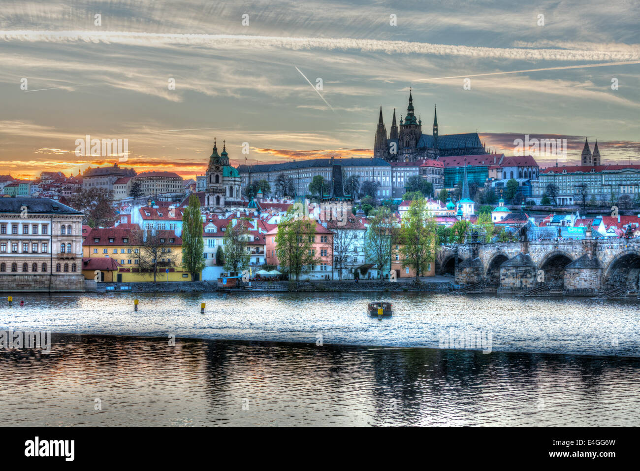 HDR image of view of Charles bridge over Vltava river and Gradchany (Prague Castle) and St. Vitus Cathedral - Stock Image