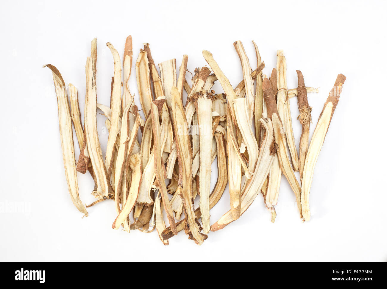 Slice liquorice roots the seasoning for cooking isolated on white background Stock Photo